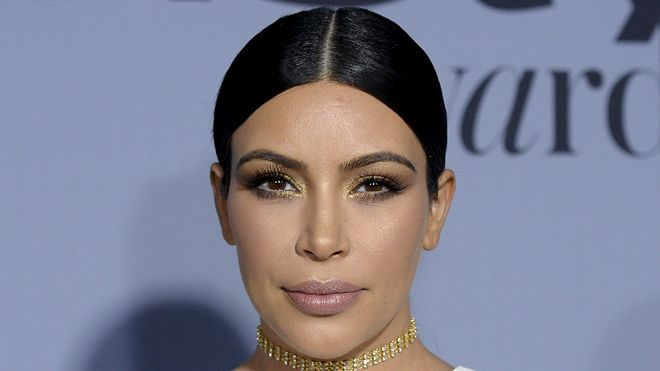 Kim Kardashian continues to flaunt 42-pound weight loss in curve-hugging dress